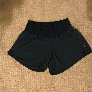 BLACK LULULEMON SHORTS size 4